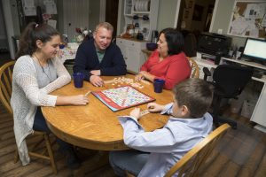 Mike Noland family enjoying scrabble game. (image)